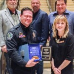 DANA Board Members Barry C. Lewis, Fred Schmidt, Warren James, Amber Galligan, and APD Commander Jason Dusterhoff with his many awards!